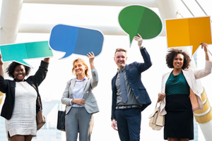 group of four people holding up speech bubbles