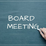 "hand is writing ""board meeting"""