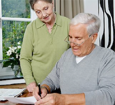 woman watching man sign document